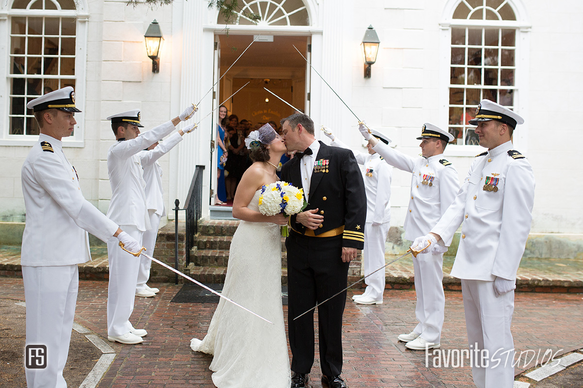 Navy Wedding Sword Arch Photo with a Kiss